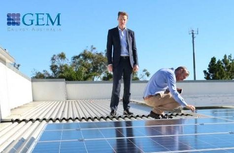 Industria REIT and GEM Energy team members survey commercial solar installation at Brisbane