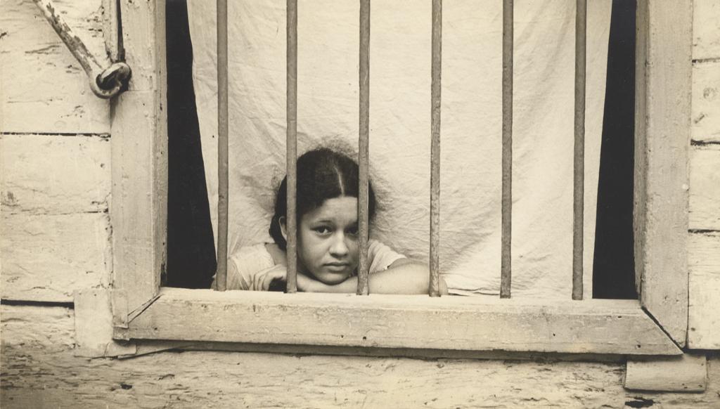 Cuban Girl Looking Through Window Bars Getty Museum