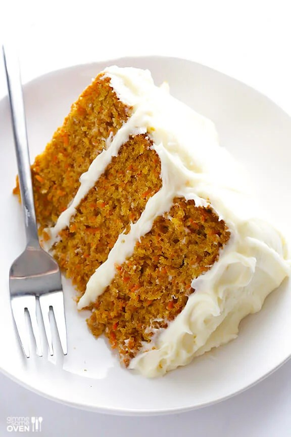 The BEST Carrot Cake Recipe   Gimme Some Oven Slice of carrot cake with cream cheese frosting