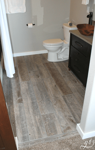 How to Tile a Bathroom Floor with Plank Tiles   Grounded   Surrounded DIY How to Lay Floor Tile Planks   Our master suite bathroom floor is  rustic and