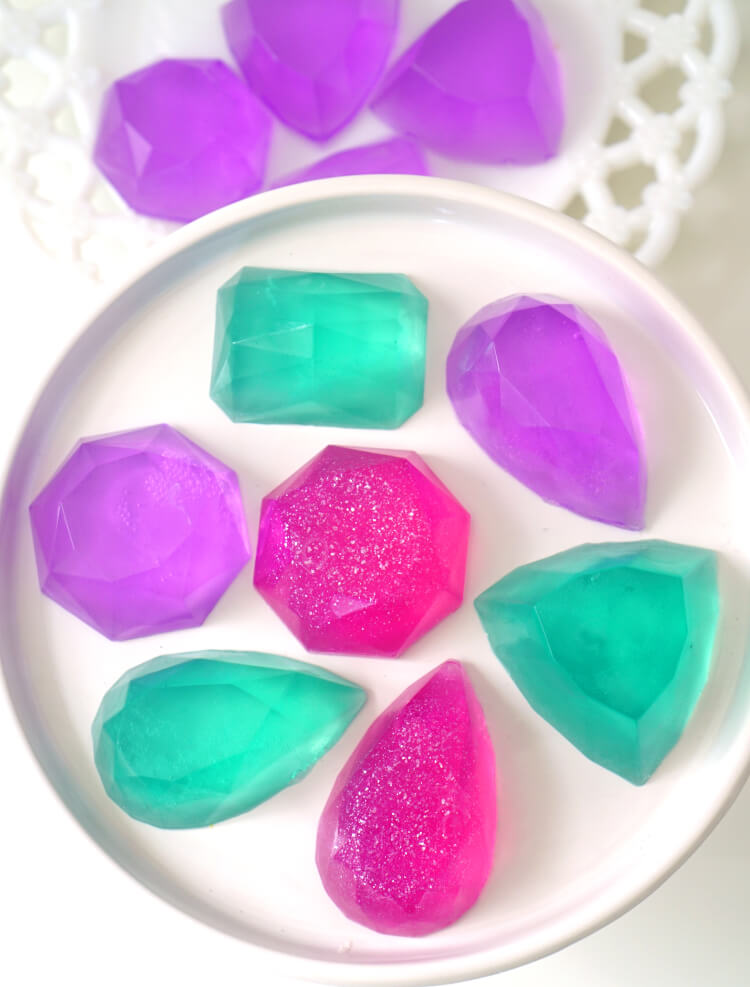 Make your own DIY Gemstone Soaps in around 10 minutes! These sparkly gem and jewel soaps are a great homemade gift idea that shimmer, shine, and smells AMAZING (in any fragrance your heart desires!)!