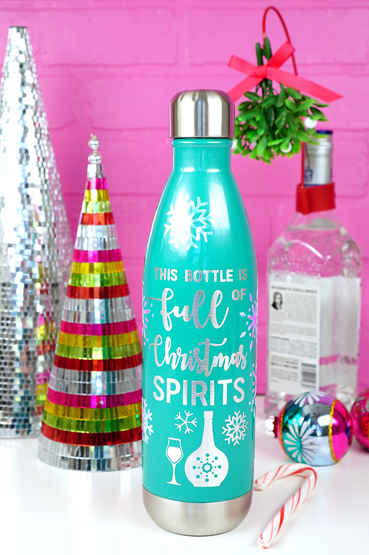 "Raise a toast to Christmas cheer with this Free SVG File - ""This Bottle is Full of Christmas Spirits!"" Great gift idea for hostesses, friends, & neighbors!"