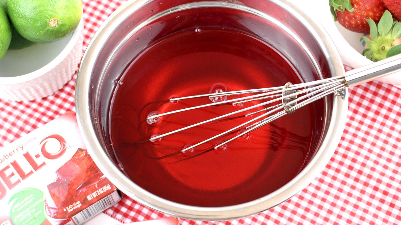 strawberry jello liquid in a bowl