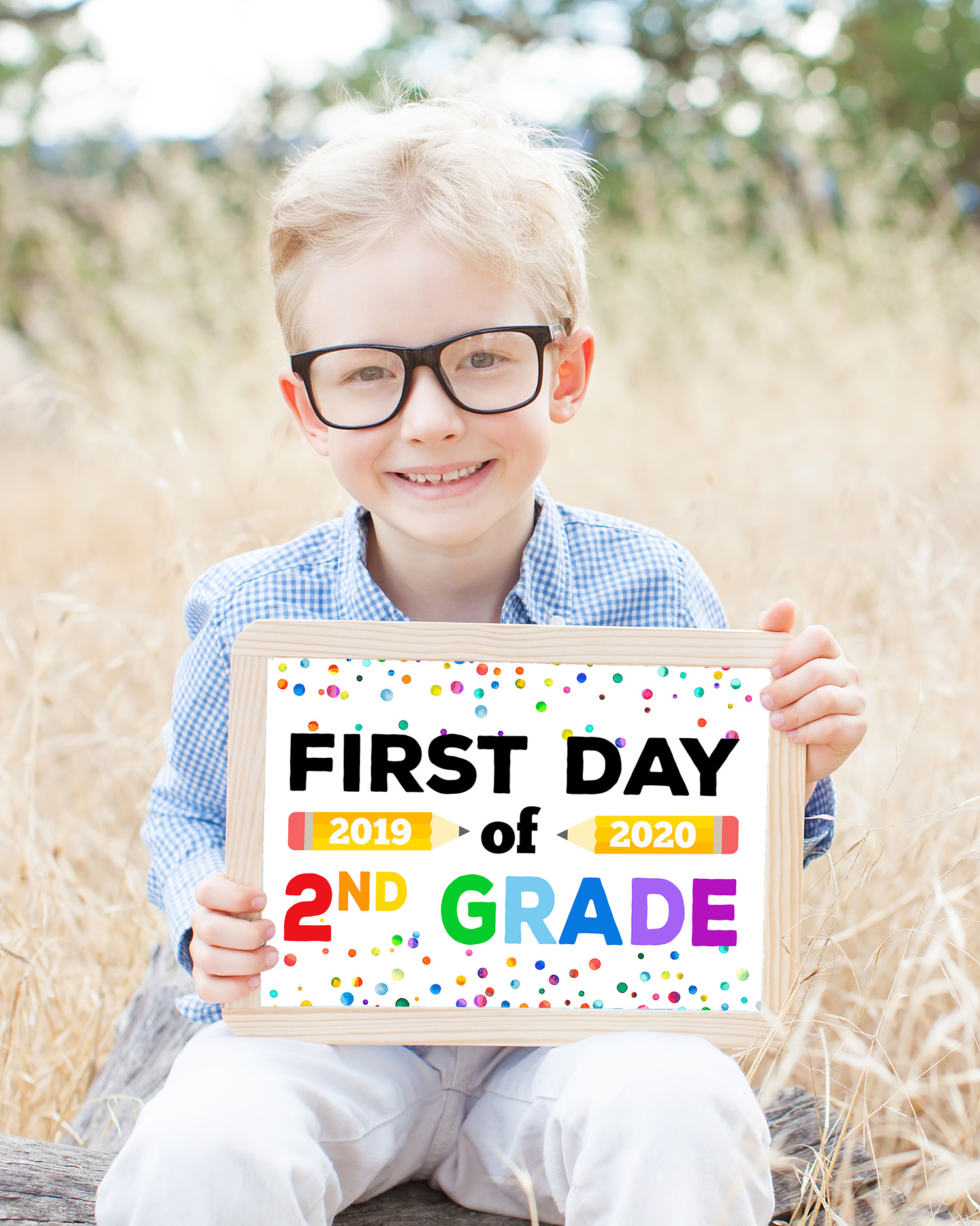 """Free Printable Back to School Signs - cute boy in glasses holding """"First Day of Second Grade"""" sign"""