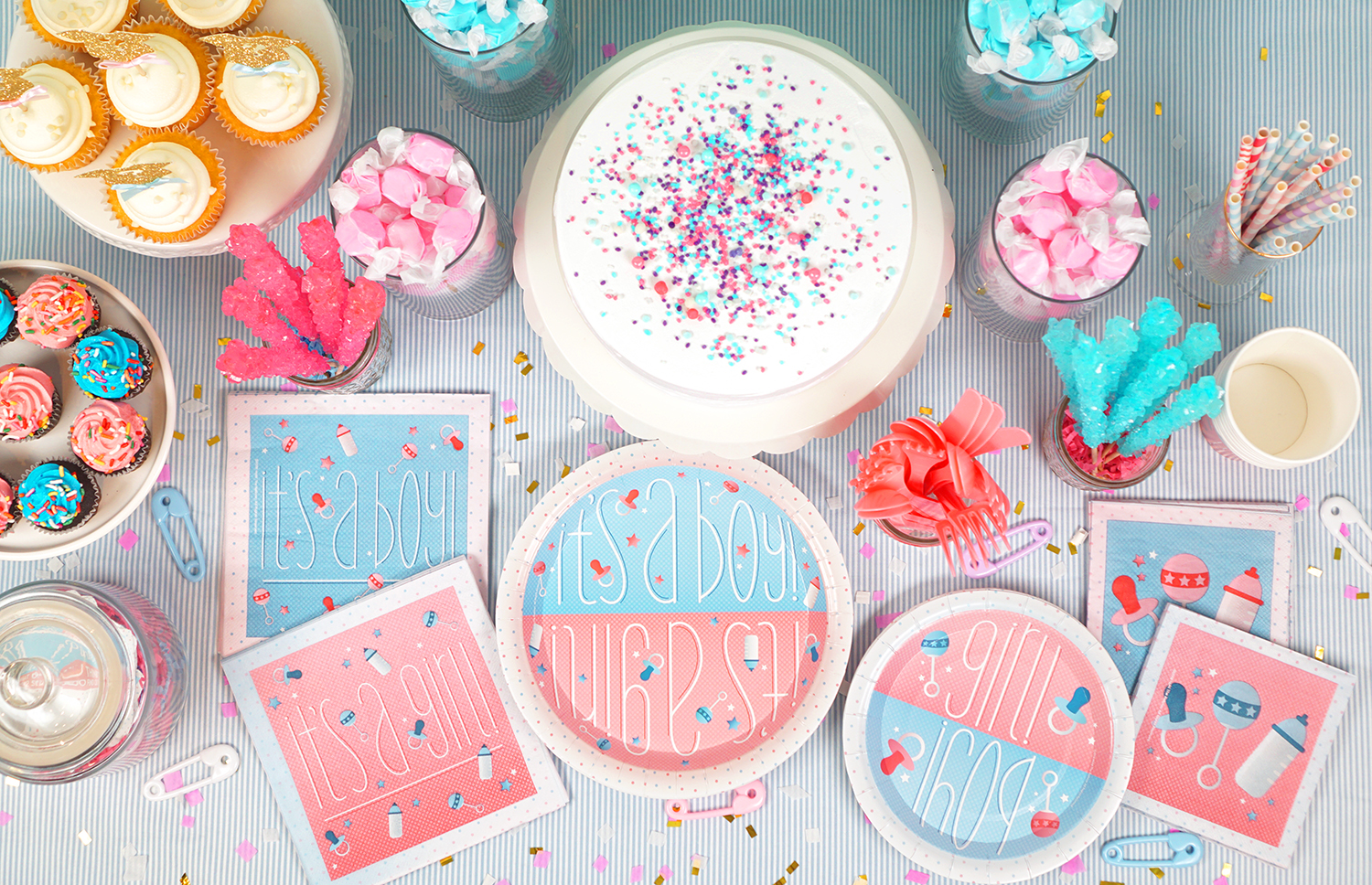 Overhead shot of gender reveal party table and paper goods