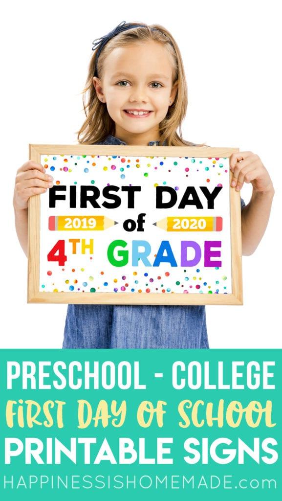 Girl holding cute First Day of School sign with rainbow letters
