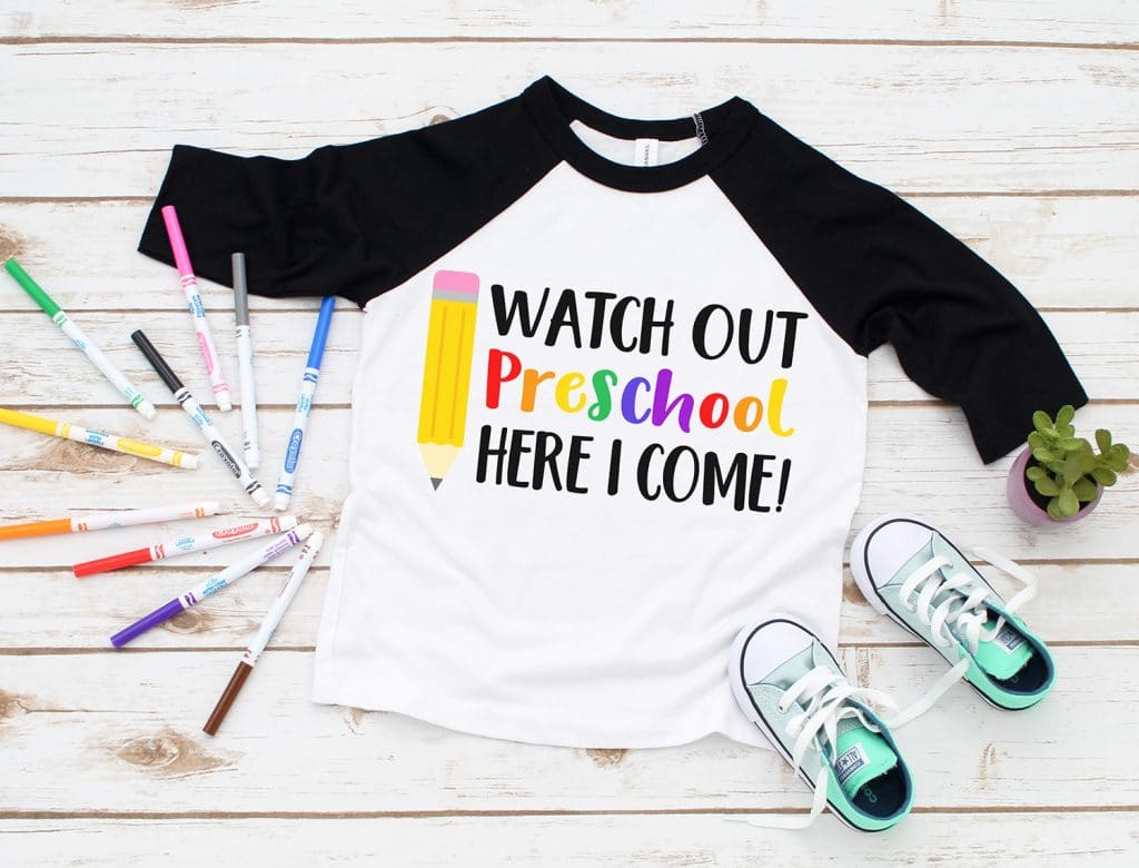 """Watch Out Preschool Here I Come\"" SVG on black raglan shirt surrounded by colorful markers and kids shoes"