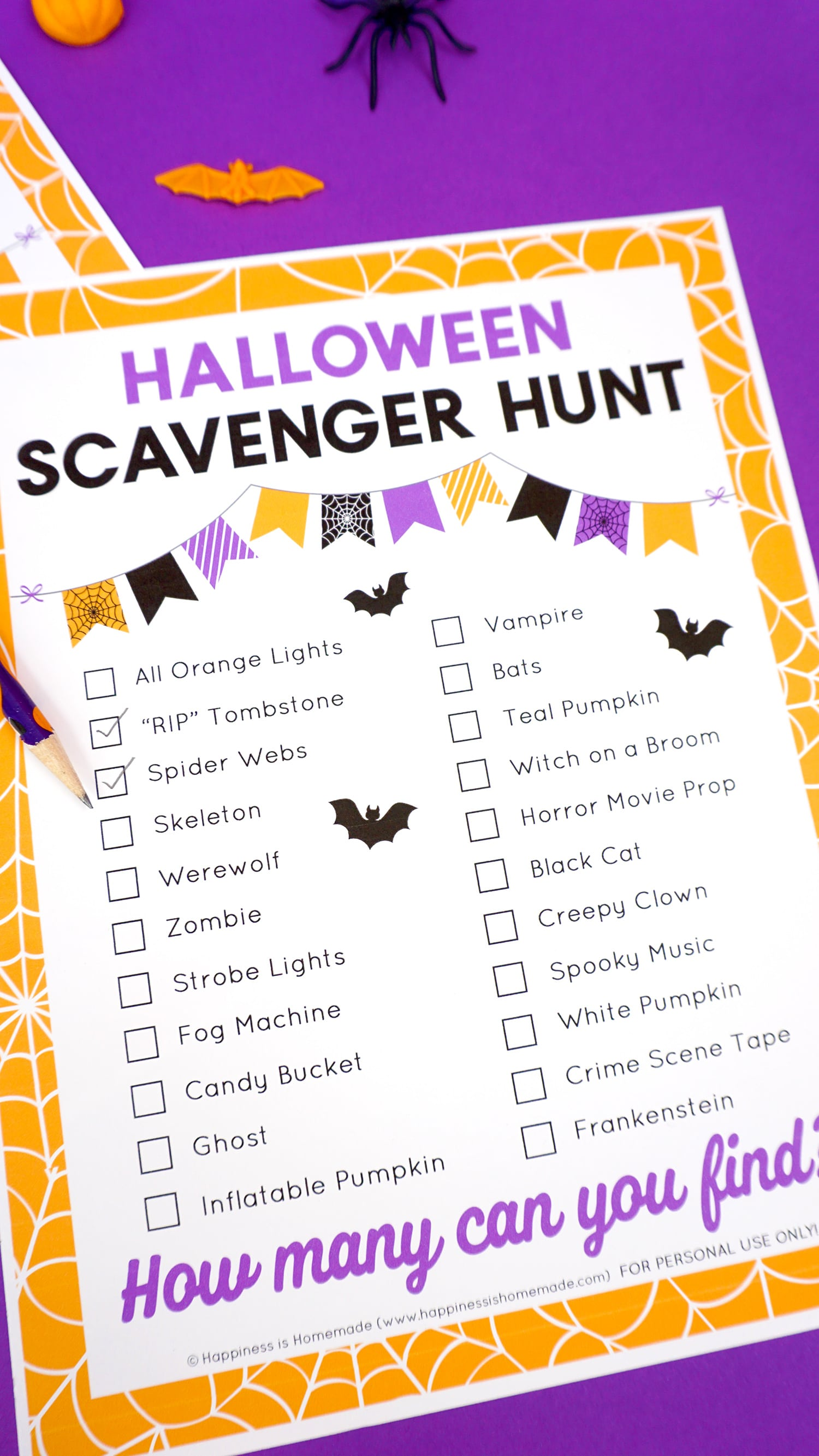 """Close up of Halloween scavenger hunt printable checklist with """"Spider Webs"""" and """"RIP Tombstone"""" checked off"""