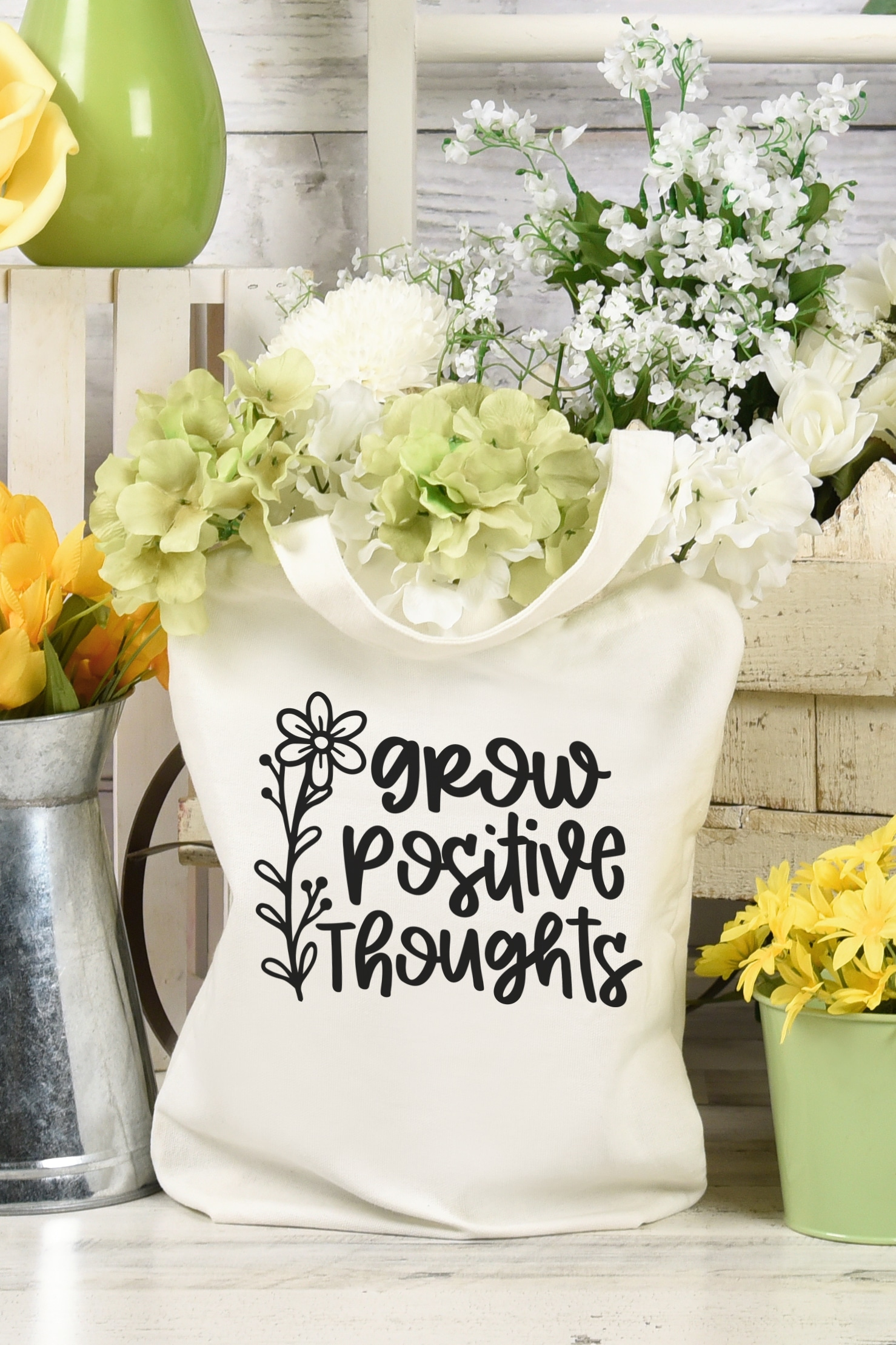 """""""Grow Positive Thoughts"""" Tote bag surrounded by white and yellow flowers"""