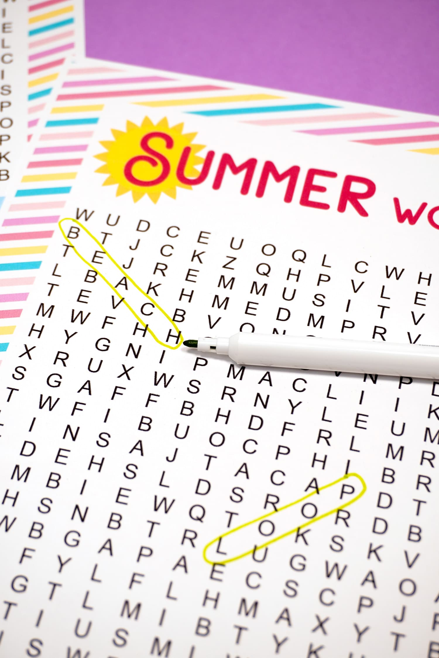 "Printable Summer Word Search with ""Beach"" circled in green marker"