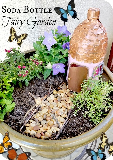 Fairy garden with fairy house made out of a recycled soda bottle