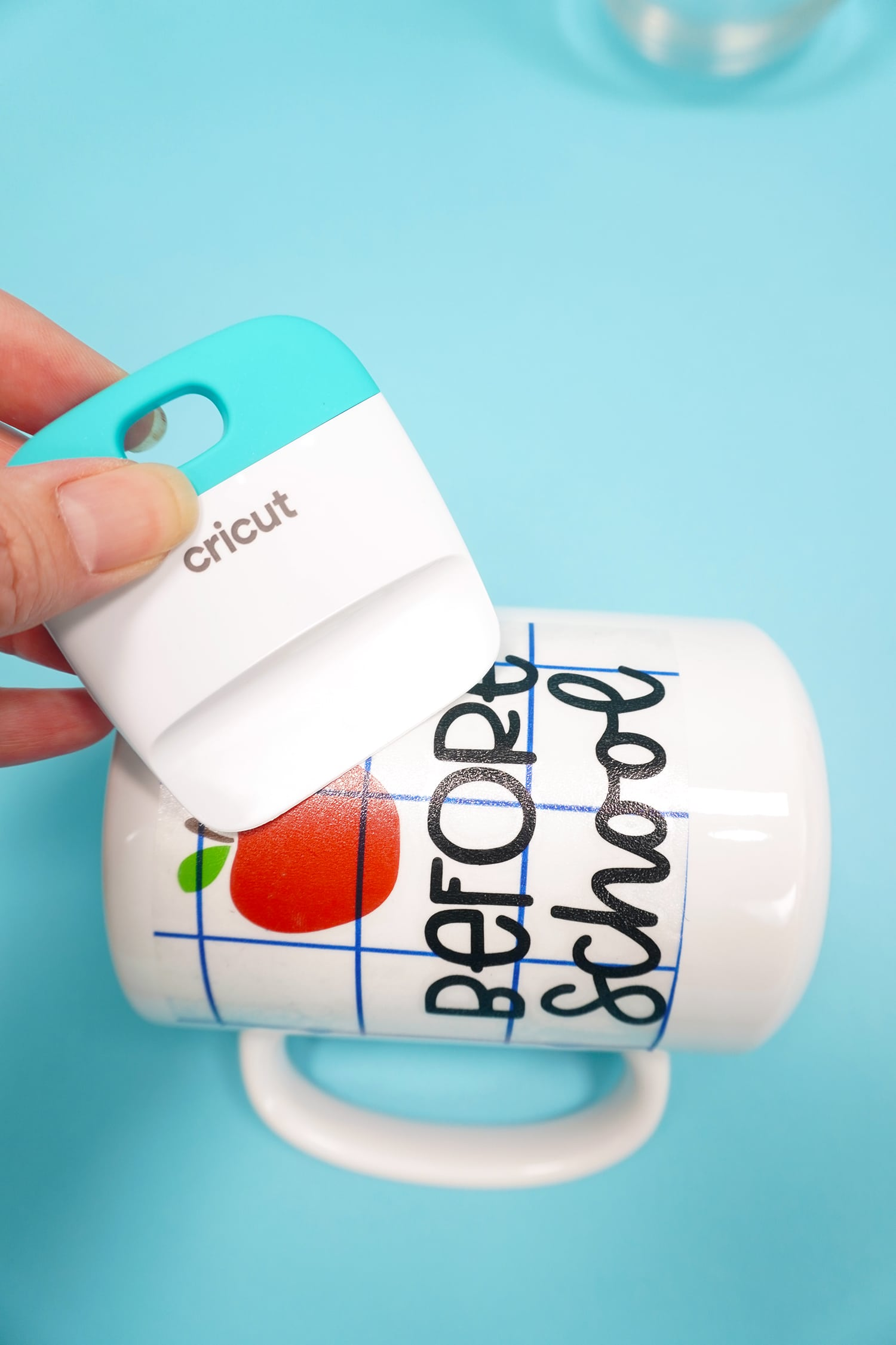 """Using a scraping tool to apply an apple and """"before school"""" design to a white mug"""