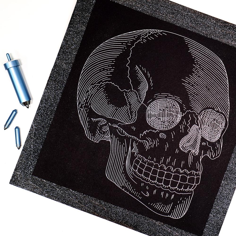 Silver skull foil art print with Cricut Foil Transfer Tool on white background