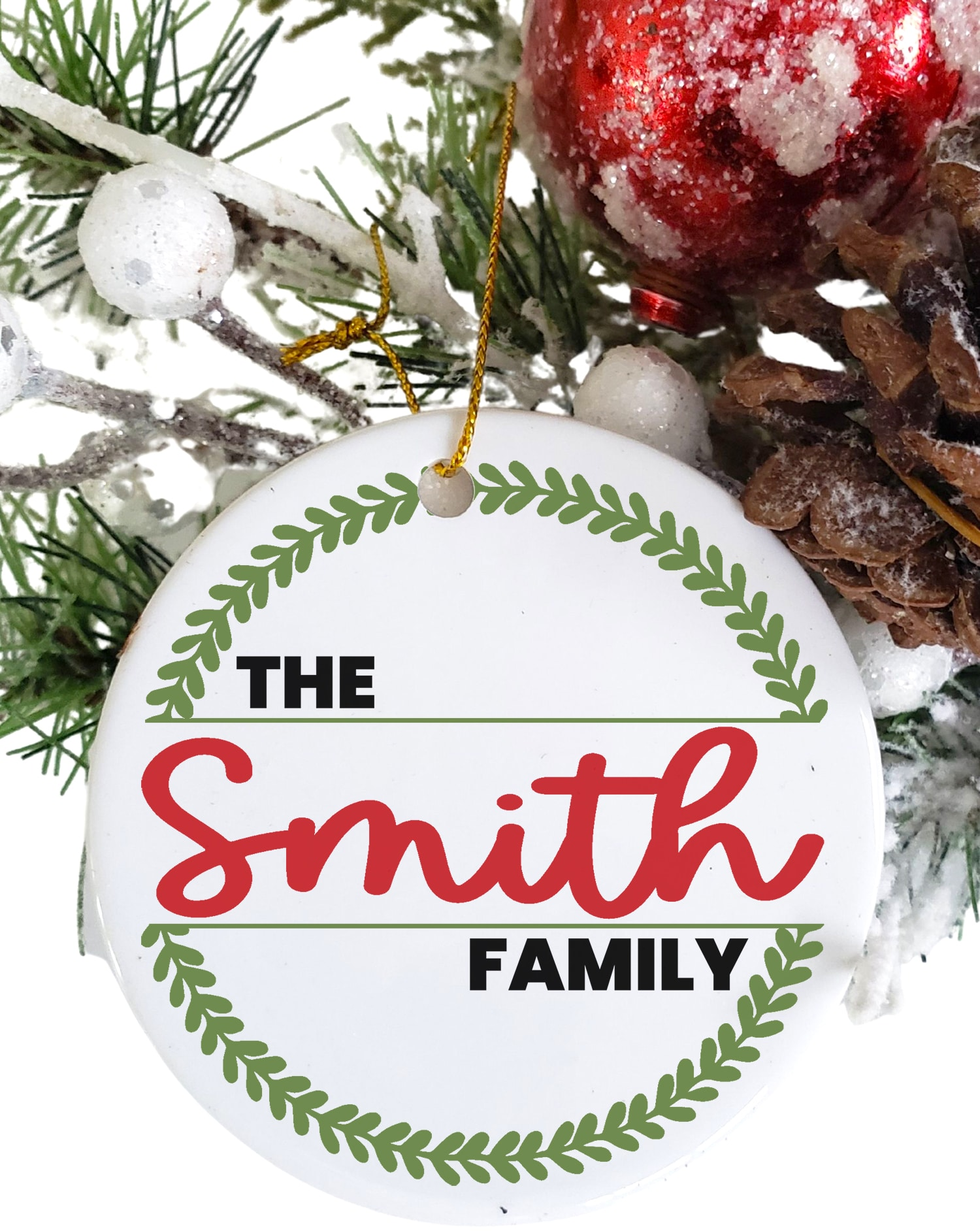 """Round white Christmas ornament with """"The Smith Family"""" and wreath design in red and green"""