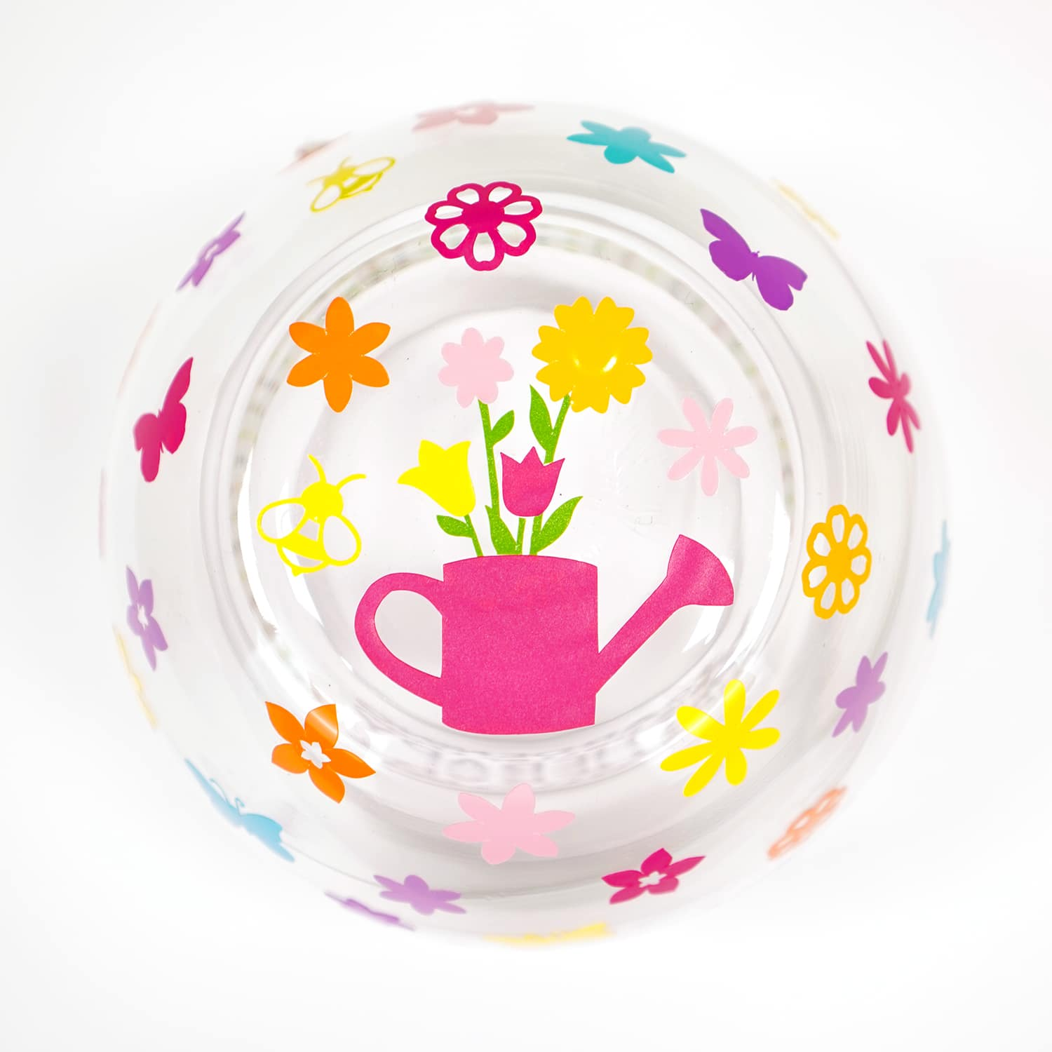Inside of garden themed wine glass - watering can and floral decals on white background