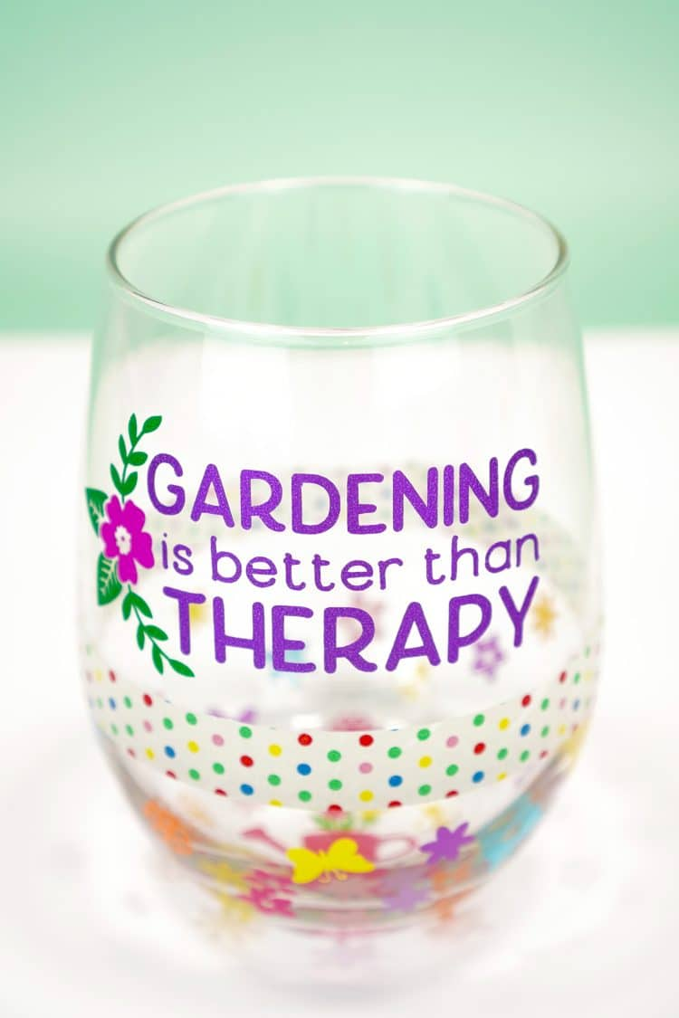 """Adding vinyl decals to a """"Gardening is Better Than Therapy"""" wine glass"""