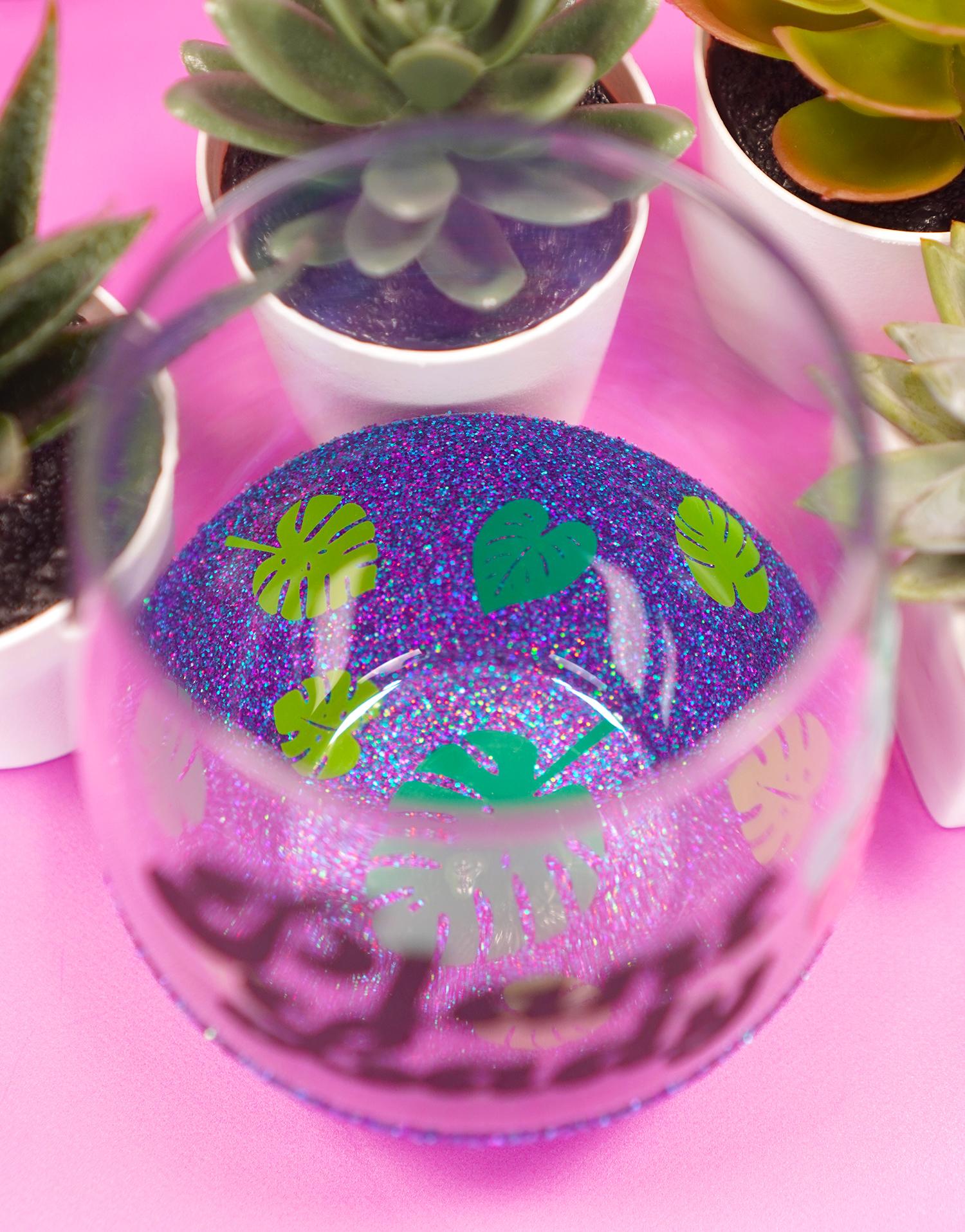 "Inside of ""Plant Lady"" peekaboo wine glass - two toned monstera leaf decals on purple glitter"