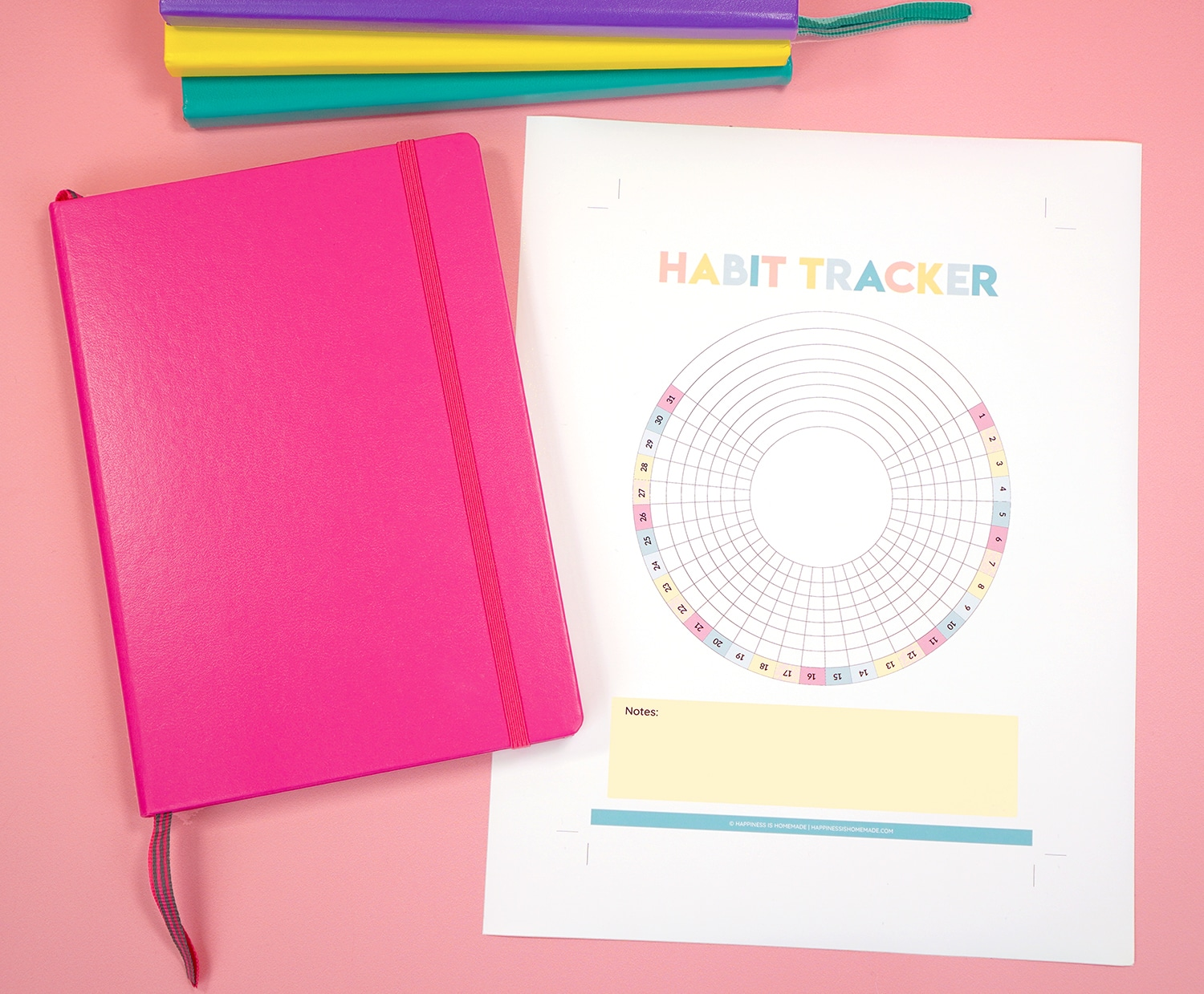 Printable Habit Tracker and bright pink bullet journal on light pink background