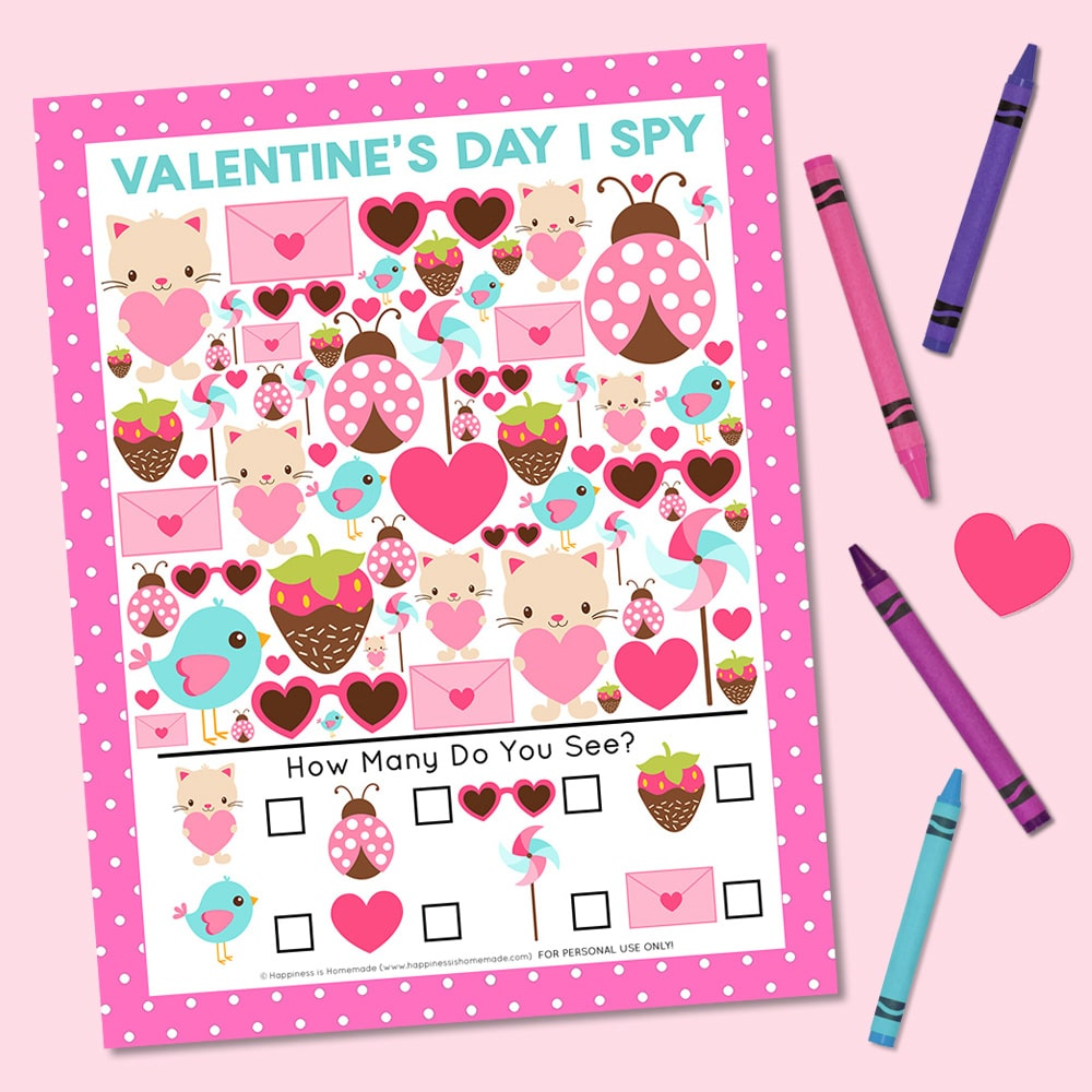 Valentine Printable I Spy Game on pink background with four crayons and heart
