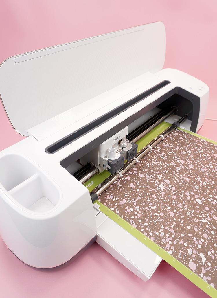 """Paint splattered"" Infusible Ink sheet on mat in Cricut Maker machine"