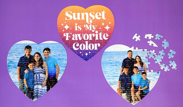 Three heart-shaped custom photo puzzles on a purple background