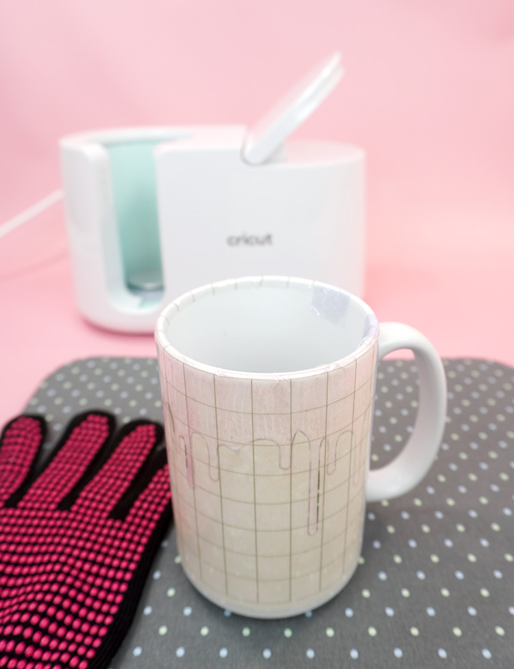 Mug with Infusible Ink design cooling on an EasyPress mat