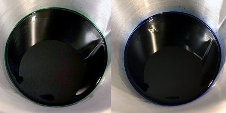 Green and blue wax melted in stainless steel pitchers