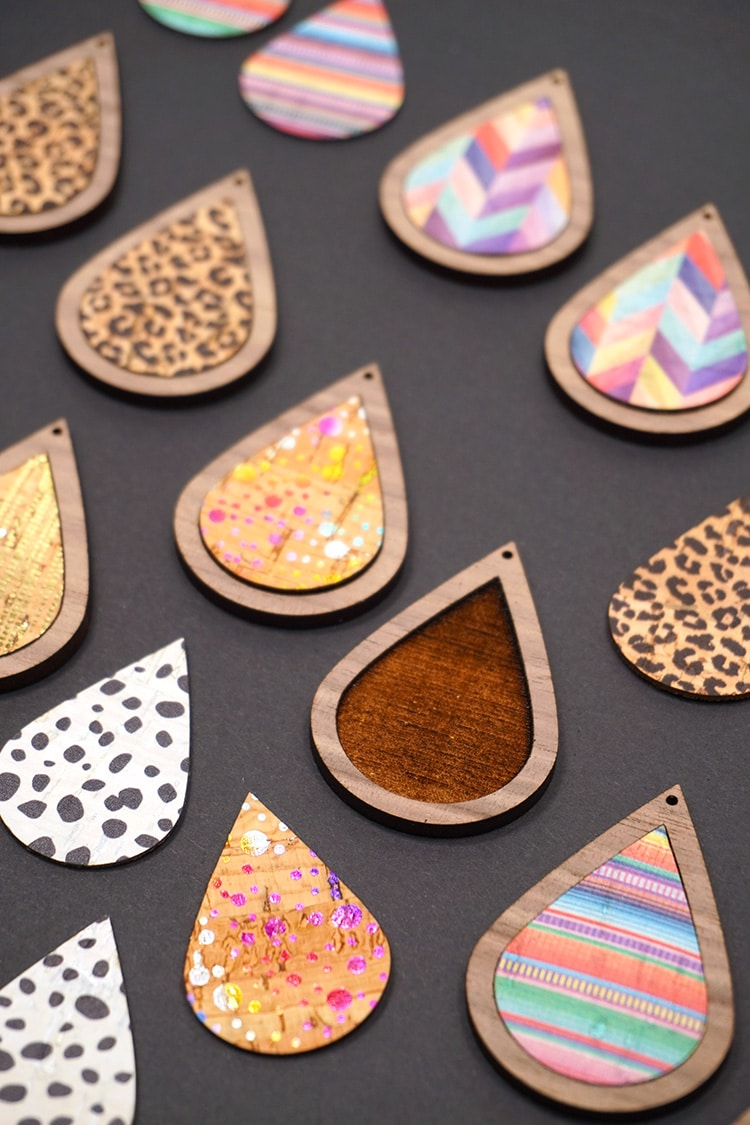 Close up of colorful teardrop shaped cork and wood pieces on a black background