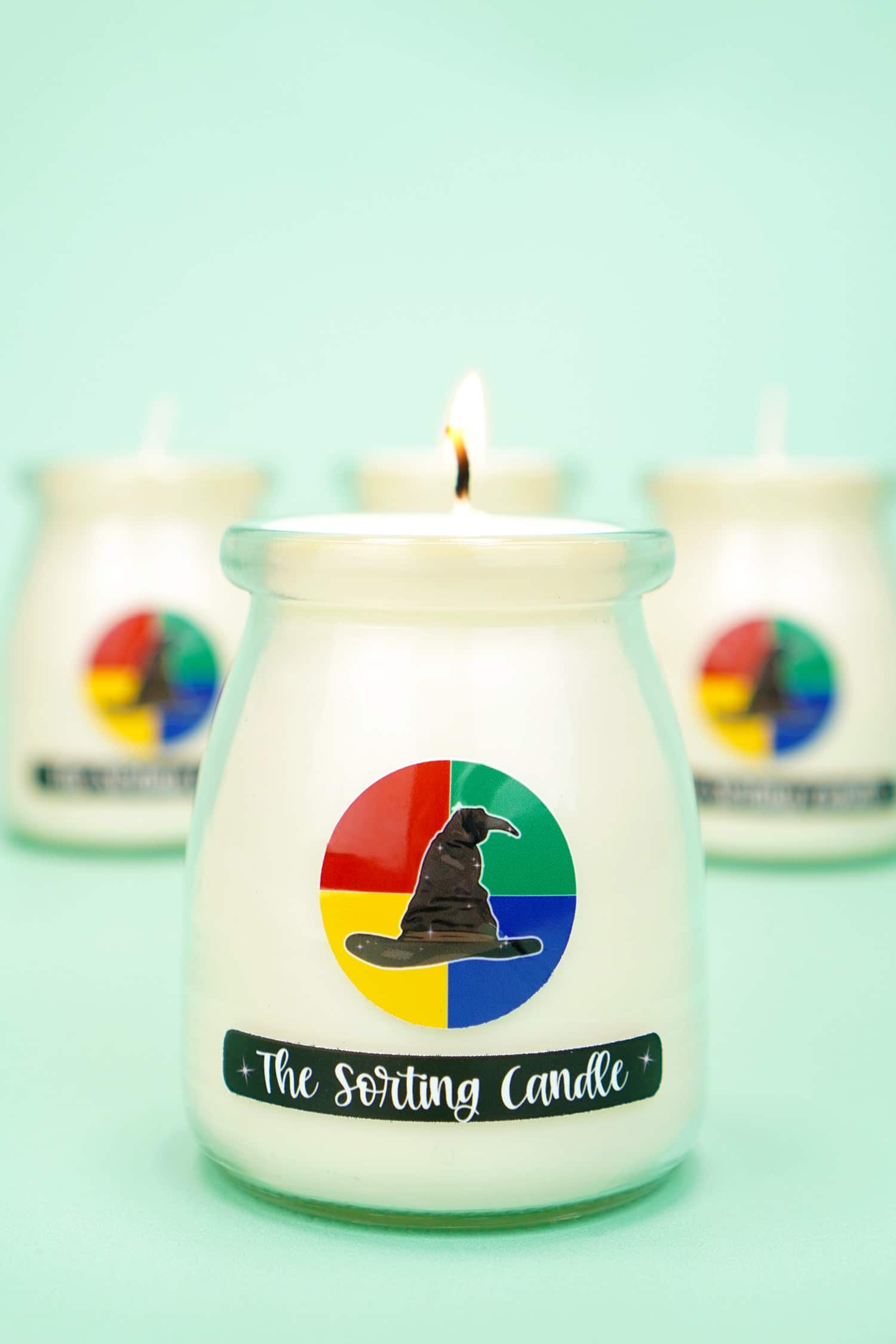 "White candle with ""The Sorting Candle"" label on mint green background"