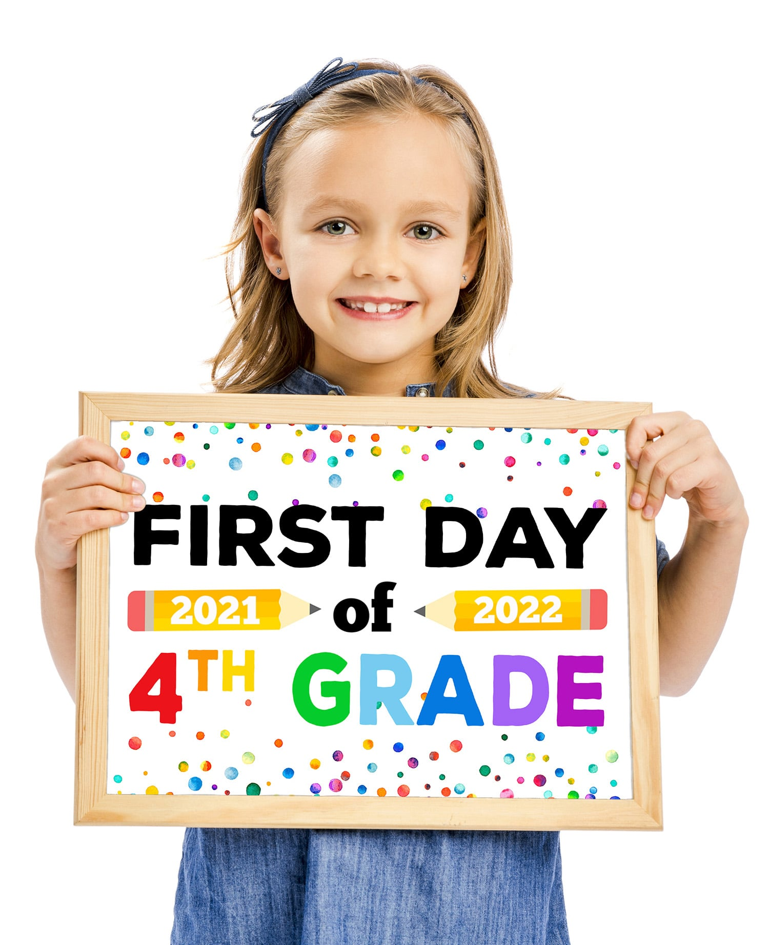 Cute brown haired girl holding a printable First Day of School Sign 2021 2022 on a white background