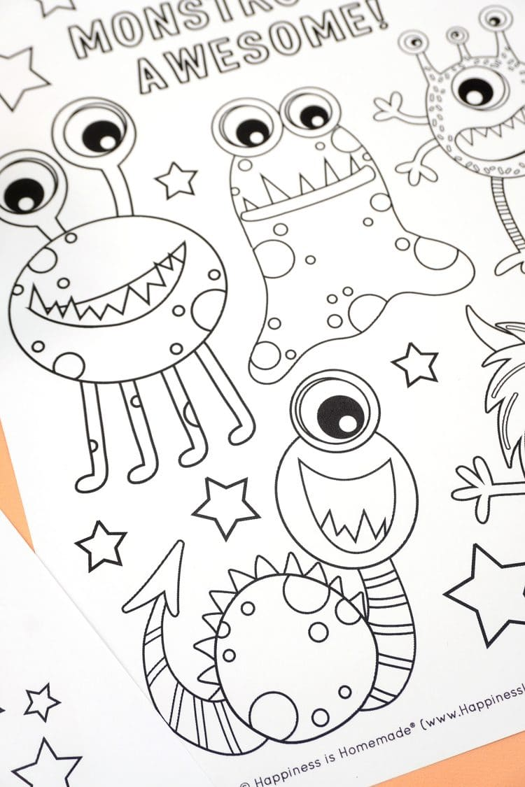 Close up detail of one-eyed smiling monster on monster coloring sheet