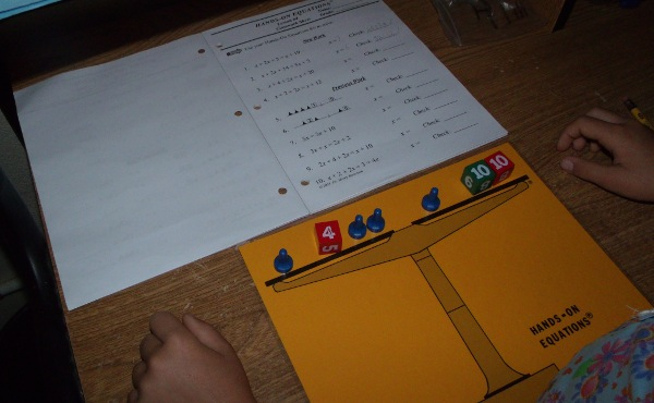 Review of Hands On Equations  a system for modeling linear equations     student using Hands On Equations program