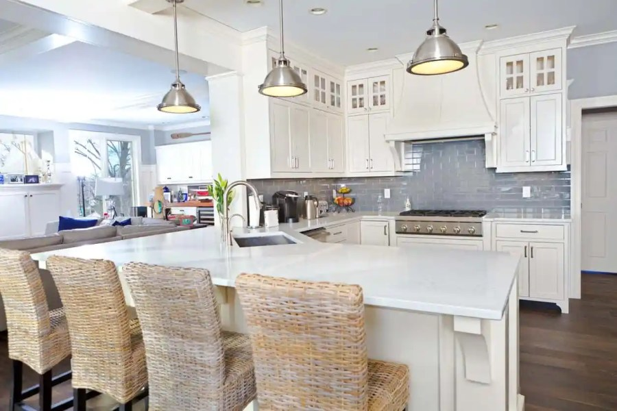 501 Custom Kitchen Ideas for 2018  Pictures  White kitchen with chrome pendant lights  blue backsplash  dark hardwood  flooring and wicker breakfast
