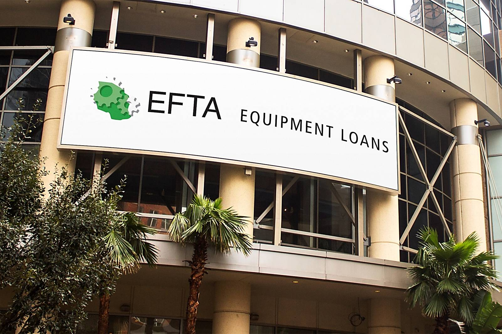 large efta banner on building with trees below