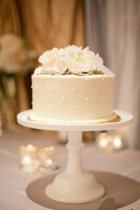 Simple  Single Tier White Wedding Cakes Polka dot pearls and florals too can come together and make something sweet