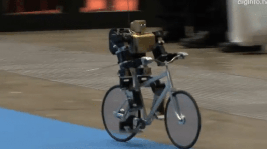 Miniature robot rides bicycle like a pro