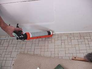 Caulk Caulk around tub perimeter