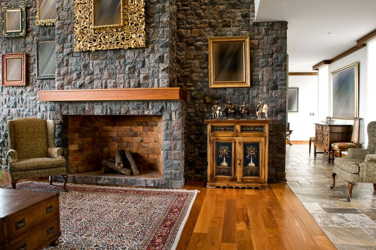 30 Gorgeous Living Rooms with Stone Walls  Pictures  A rugged stone wall adds loads of character to this traditional living  space  The dark gray slate is an ideal complement to the warm wood  flooring