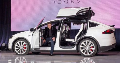 Tesla s latest car can protect you from a chemical attack Zombie proof  Elon Musk with Tesla s new Model X  Photograph  David Paul