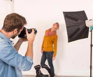 Professional Photographer Jobs in the Modeling and Fashion Industry Fashion Photographer doing Photo Shoot with Female Model