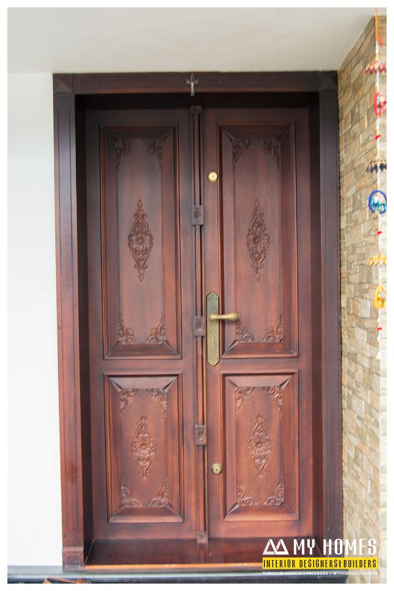 Delicate Front Wooden Door Designs Kerala
