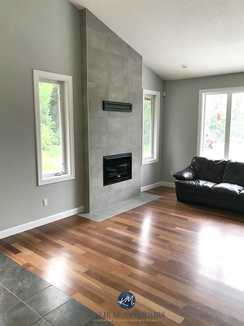 The 9 Best Benjamin Moore Paint Colors     Grays  Including Undertones  Benjamin Moore Stonington Gray  living room  wood flooring  cement colour  gray tile fireplace