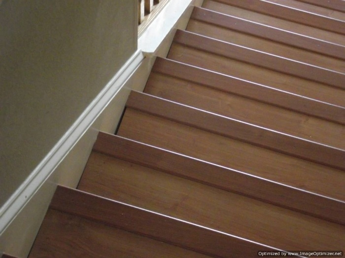 Laminate On Stairs With Bad Installation   Wood Floor Step Edge   Stair Tread   Staircase   Engineered Hardwood   Trim   Carpeted Stairs