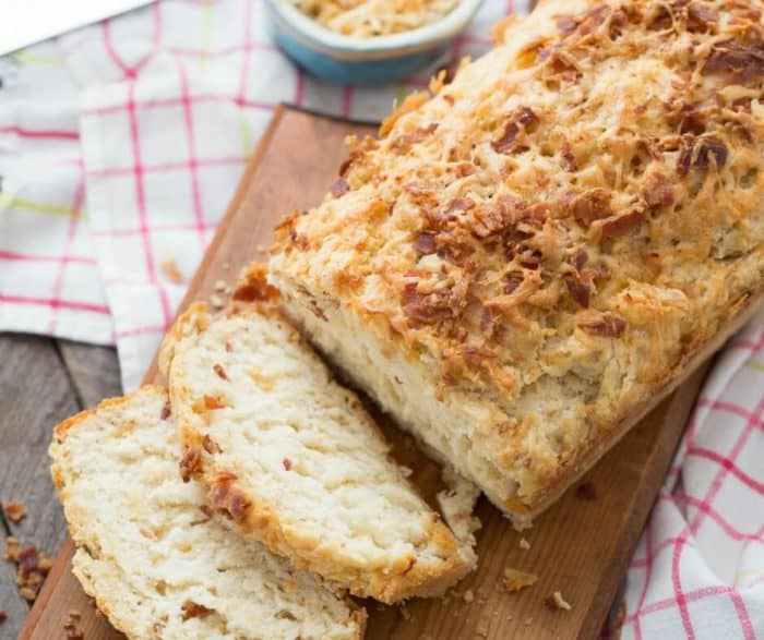This bacon cheddar beer bread is amazing! Lots of bacon, creamy cheese and your favorite beer will bake up the most amazing bread you've ever tasted!