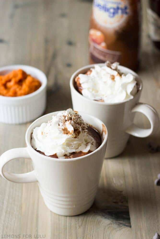 This simple hot chocolate recipe incorporates pumpkin puree, pumpkin spice and chocolate for a rich and cozy treat! www.lemonsforlulu.com #IDelight