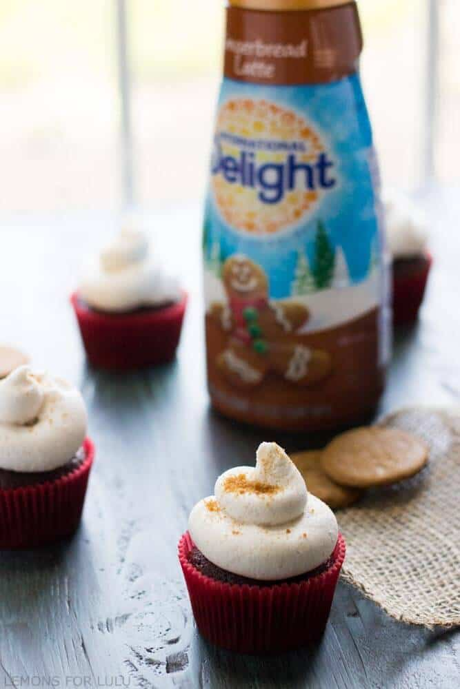 These gingerbread cupcakes are like Christmas, wrapped inside of dessert! Chocolate coffee flavored cupcakes topped with a rich and creamy gingerbread latte buttercream! www.lemonsforlulu.com