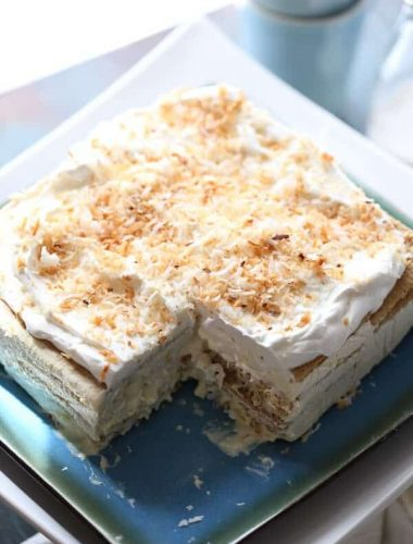 This vanilla coconut ice box cake is light and absolutley dreamy! A no bake treat that tastes purely decadent! lemonsforlulu.com #IDelight @InDelight