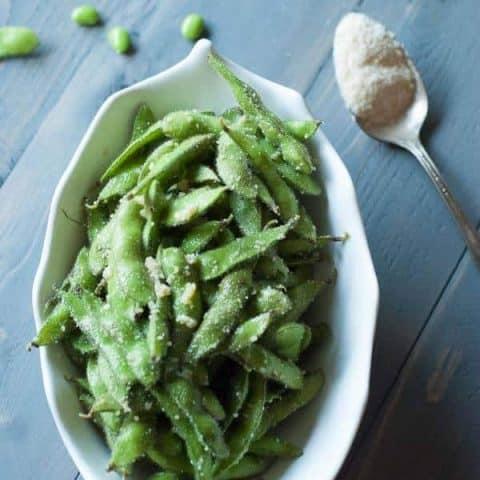 Edamame coated in olive oil, lots of garlic and Parmesan cheese! lemonsforlulu.com