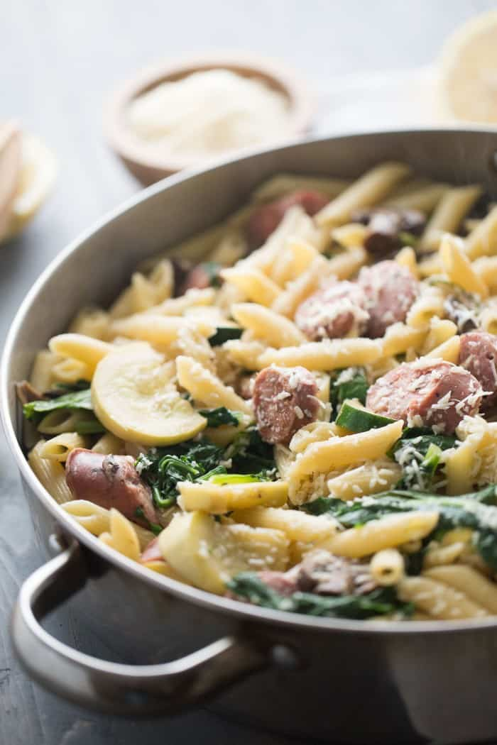 A simple penne pasta recipe made with chicken sausage and loads of fresh veggies! lemonsforlulu.com