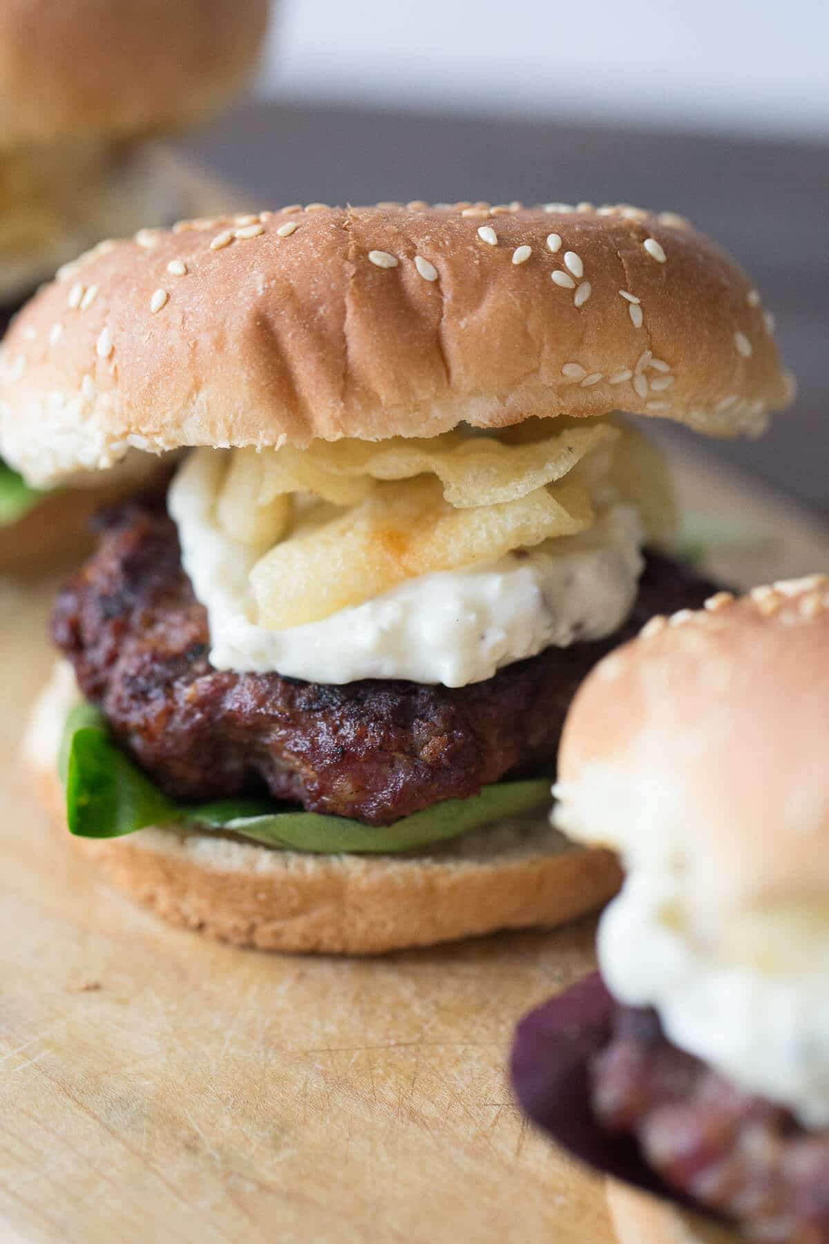 These black and blue burger is thick and juicy and holds so many unexpected flavors. Spicy seasoning, creamy remoulade and crunchy chips make this burger outstanding!